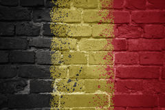 Painted national flag of belgium on a brick wall. Colorful painted national flag of belgium on a old brick wall stock images
