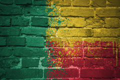 Painted national flag of benin on a brick wall Royalty Free Stock Image