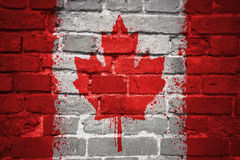 Painted national flag of canada on a brick wall Stock Photo