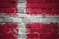 Painted national flag of denmark on a brick wall Royalty Free Stock Images