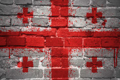 Painted national flag of georgia on a brick wall. Colorful painted national flag of georgia on a old brick wall Stock Photography