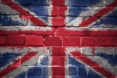 Painted national flag of great britain on a brick wall. Colorful painted national flag of great britain on a old brick wall Stock Photo