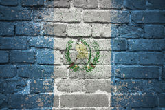 Painted national flag of guatemala on a brick wall stock photos
