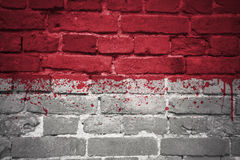 Painted national flag of indonesia on a brick wall royalty free stock images