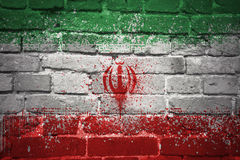 Painted national flag of iran on a brick wall stock photos