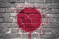 Painted national flag of japan on a brick wall royalty free stock photo