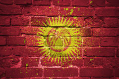 Painted national flag of kyrgyzstan on a brick wall Stock Images