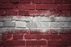 Painted national flag of latvia on a brick wall Royalty Free Stock Image