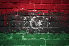 Painted national flag of libya on a brick wall Royalty Free Stock Photos