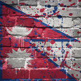 Painted national flag of nepal on a brick wall Royalty Free Stock Image
