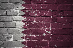 Painted national flag of qatar on a brick wall Royalty Free Stock Photography