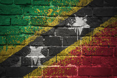 Painted national flag of saint kitts and nevis on a brick wall Royalty Free Stock Images