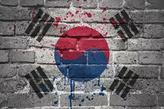 Painted national flag of south korea on a brick wall. Colorful painted national flag of south korea on a old brick wall royalty free stock image
