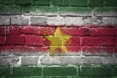 Painted national flag of suriname on a brick wall Royalty Free Stock Image