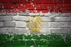 Painted national flag of tajikistan on a brick wall Royalty Free Stock Image