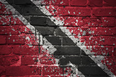 Painted national flag of trinidad and tobago on a brick wall Royalty Free Stock Images