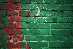 Painted national flag of turkmenistan on a brick wall Royalty Free Stock Photo