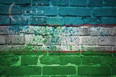 Painted national flag of uzbekistan on a brick wall Stock Photo