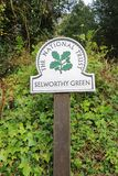 English National Trust sign. A painted National Trust sign at Selworthy Green in the county of Somerset in England Royalty Free Stock Photography