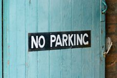 Painted No Parking sign on garage door royalty free stock photo