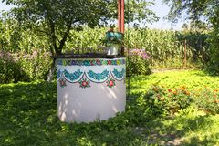 Painted old well decorated with a hand painted colorful flowers, Zalipie, Poland. ZALIPIE, POLAND - AUGUST 2, 2018:Painted old well decorated with a hand painted royalty free stock images