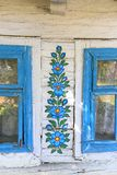 Painted old wooden cottage decorated with a hand painted colorful flowers, Zalipie, Poland. ZALIPIE, POLAND - AUGUST 2, 2018: Painted old wooden cottage stock image