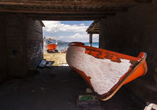 Painted orange boat Royalty Free Stock Photos