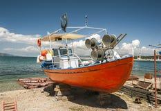 Painted orange boat Stock Images