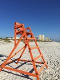 Orange Colored Lifeguard Chair in Jacksonville Beach Florida USA. A painted orange colored lifeguard chair is empty along a beach in Jacksonville Beach Florida stock images