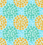Painted orange and green dotted circles on blue dots Royalty Free Stock Photo