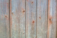 Painted orange old faded wooden planking background with flaws. On it surface stock photo