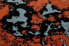 Painted in orange wall peeling off Stock Image