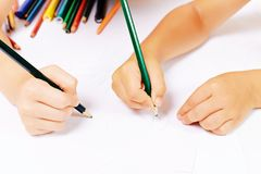 Painted on paper. Children's hands painted on paper Royalty Free Stock Photography