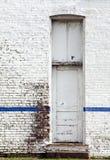Painted peeling white brick Stock Photo