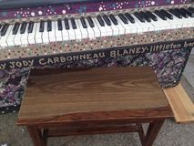 Painted piano. Quirky painted piano in downtown wolfeboro Royalty Free Stock Photography