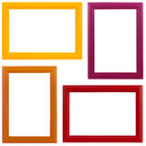 Painted picture frames. Four multicolored wooden picture frames on white background royalty free stock images