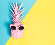 Painted pineapple with sunglasses. On a vibrant duotone background Royalty Free Stock Photo