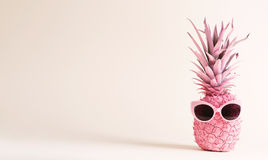 Painted pink pineapple with sunglasses Royalty Free Stock Photo