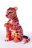 Painted plasticine tiger. Painted plasicine sitting tiger isolated over white Royalty Free Stock Photo