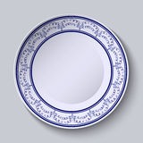 Painted plates with a blue ornament in ethnic style with an empty space in the center. Royalty Free Stock Photos