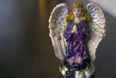 Porcelain figurine of an angel with golden hair. royalty free stock images