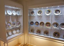 Painted porcelain plates at the Imperial Silver Collection at the Hofburg. Shelving with goldware, which was used by the Habsburg emperors in the Imperial Silver royalty free stock images