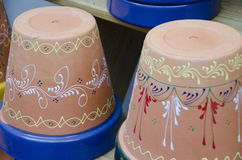 Painted Pots. Terra cotta pots with painted designs Stock Photos