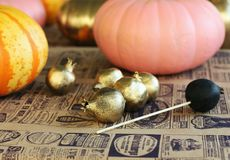 Painted pumpkins and gold garnets on the craft paper in the crea. Tive studio Royalty Free Stock Image