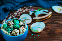 Painted quail eggs over rustic wooden background Stock Images