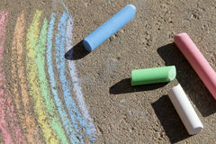 Painted rainbow colored chalk. On the pavement Stock Image