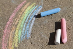 Painted rainbow colored chalk. On the pavement Stock Images