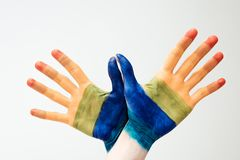 Painted in rainbow hands. Cropped image of painted in rainbow hands isolated on white royalty free stock images