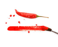 Painted red color chili on white background, with brush Royalty Free Stock Photos