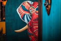 Painted red elephant. An elephant is painted on the wall. Red indian elephant stock photo